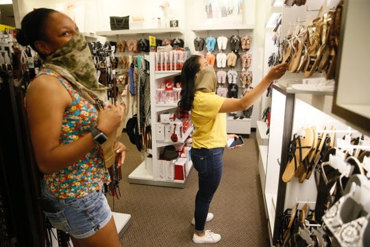 Kennedy Driscoll, left, and Lidia Velasquez shop Wednesday, May 20, 2020, at J.C. Penney at Cielo Vista Mall in El Paso. Driscoll and Velasquez were looking for summer clothing. They moved from Michigan at the beginning of March for training at Fort Bliss.