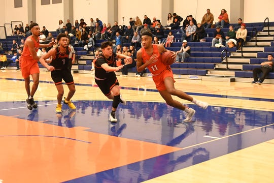 Savion Johnson, 11, helped the COS men's basketball team to a 24-6 overall record this past season.