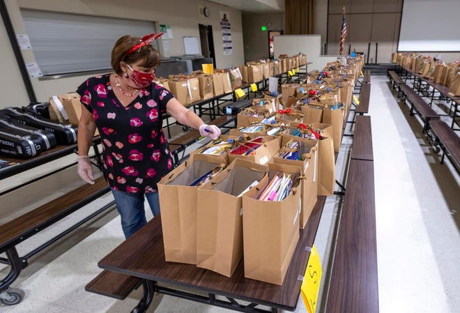 Hurley Elementary School Principal Lisa Whitworth and her staff distribute the belongings of more than 600 students Tuesday, May 19, 2020. The week is also a chance to return items like library books and musical instruments.