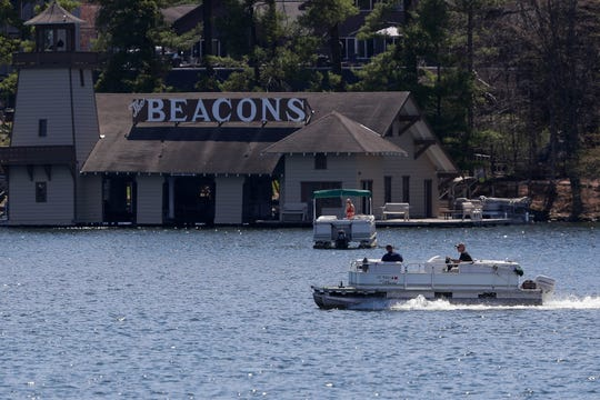 A pontoon boat motors across the water Wednesday on Minocqua Lake in Minocqua.