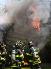 Hartsdale firefighters work at the scene of a house fire at 3 Edgewood Road in Hartsdale May 20, 2020. Firefighters from Greenville, Fairview, Scarsdale and White Plains assisted at the scene.