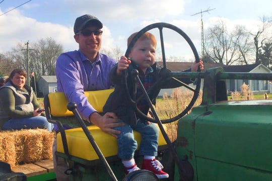 Ted Bobola with his son at his family's farm west of Dover.