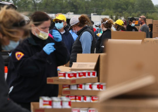 The Food Bank of Delaware, DelDOT, the Delaware Army National Guard and scores of volunteers come together to serve as many as 2500 families in the Food Bank's Drive-Thru Mobile Pantry Wednesday at Dover International Speedway.