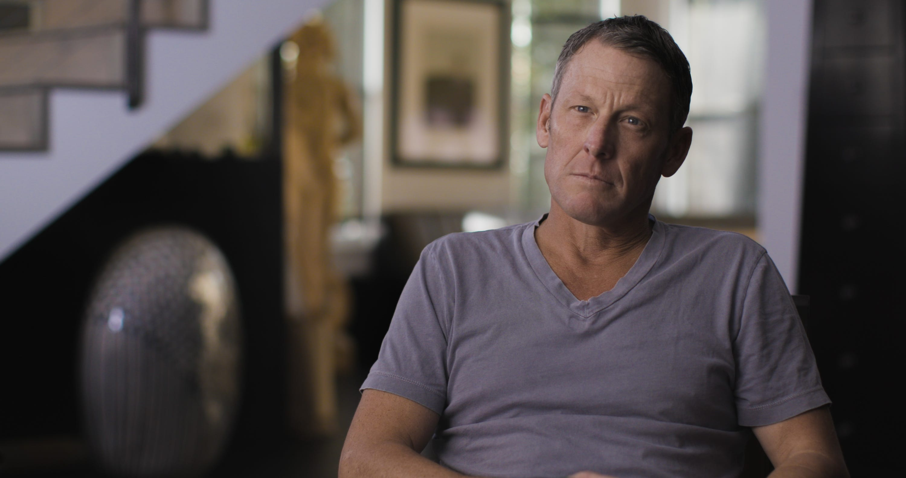 Lance Armstrong says in film that stepfather  beat the (expletive) out of me