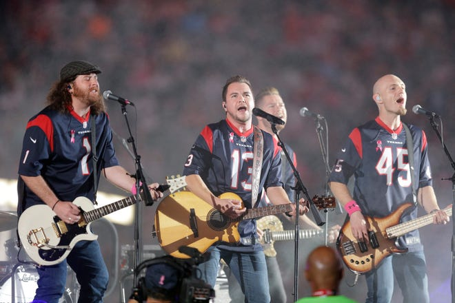 This Oct. 9, 2014 file photo shows The Eli Young Band performing during halftime of an NFL football game in Houston.