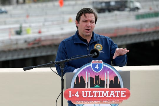 Florida Gov. Ron DeSantis speaks at a news conference May 18 in Orlando about plans to reopen the state amid coronavirus.