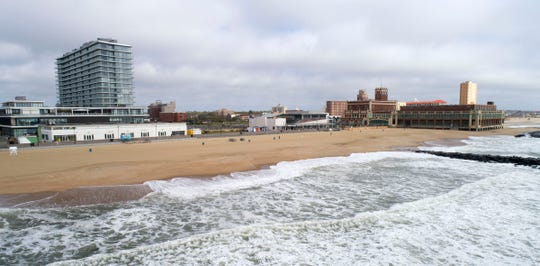 Waves lap onto the Asbury Park beach Thursday morning, May 21, 2020, before the Memorial Day crowds arrive.
