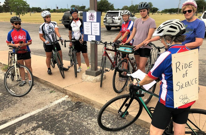With this year's Rides of Silence to honor those who have died on the road curtailed by COVID-19, the Abilene Women's Cycling Connection held a smaller event Wednesday in the Redbud Park area. Member Kathy Strong, right, read a poem before the ride. The annual event is the third Wednesday in May and usually draws dozens of local cyclists. Posted on a light pole were the names of those being honored: Bernard Eguia (April 2010), Sam Carroll, Susan Gerred, August Salazar, Jessie Tijerina, Valentin Papadin, Nathan Fife, Casey Ellis, Terry Fillmon and April Gist, the last to die in March 2018.