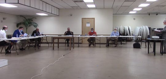 The Madison County Board of Commissioners met in person with social distancing measures in place May 19.