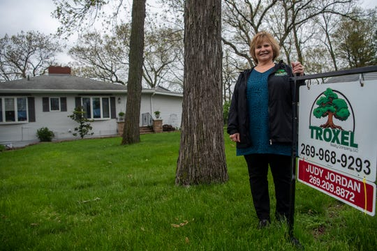 Realtor Judy Jordan is showing a home for sale on Saint Mary's Lake, pictured on Tuesday, May 19, 2020 in Battle Creek, Mich.