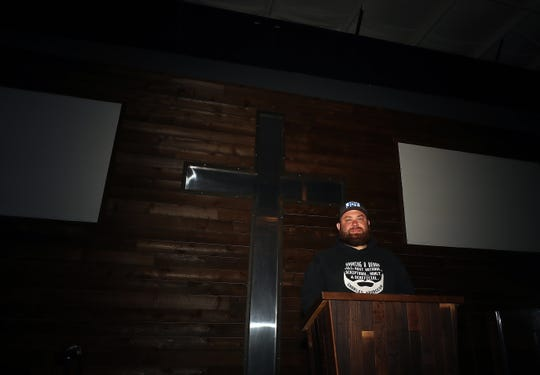 Pastor Brandon Johnston stands in an empty Coram Deo Church in East Bremerton on May 21. He says he's realized he misses the sounds of crying babies as the church modifies its services in the wake of coronavirus. And also, communion elements ruining his pants, he said.