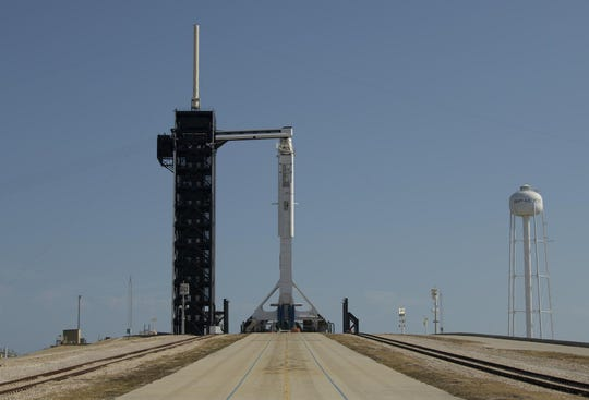 A SpaceX Falcon 9 rocket topped with a Crew Dragon capsule rolls out to the pad at Kennedy Space Center's pad 39A on Thursday, May 21, 2020.