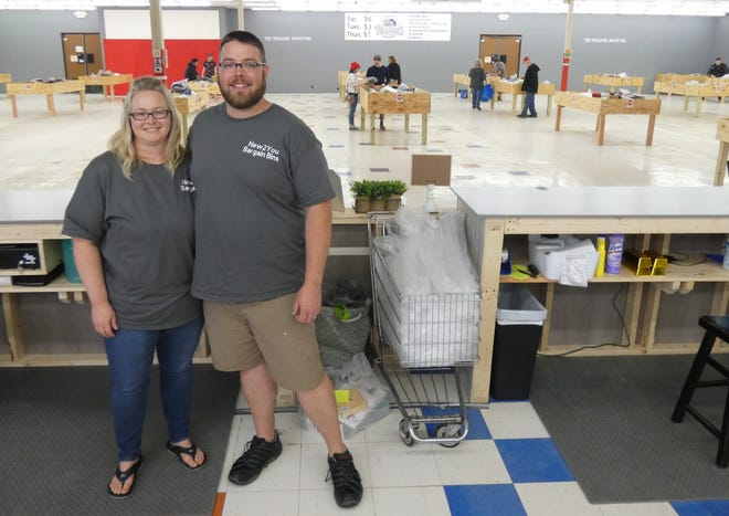 Eliza and Matt Cole stand in the front of their new store, New2You Bargain Bins - The Unknown Treasures, on Marion Road.