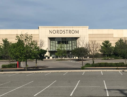 A parking lot was empty Wednesday outside the closed Nordstrom store at Cherry Hill Mall.