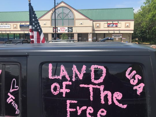 A vehicle sends a message of support outside The Atilis Gym in Bellmawr Friday.