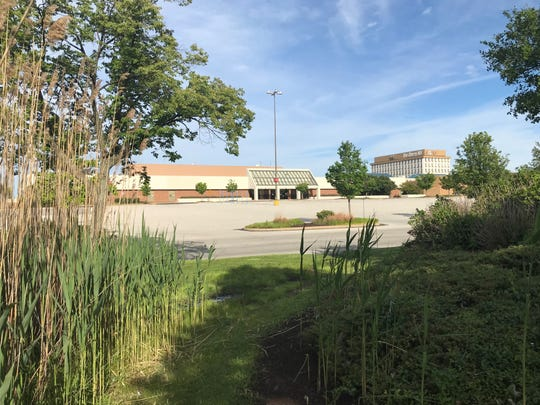 The Cherry Hill Mall, largely idled due to ongoing pandemic, is seen from landscaping along Haddonfield Road.