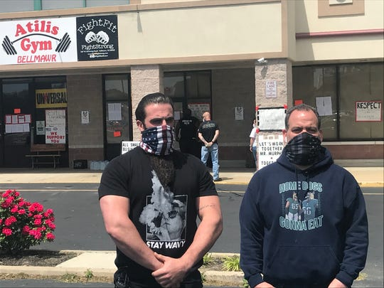 Ian Smith, left, and Frank Trumbetti stand outside The Atilis Gym in Bellmawr on Thursday.