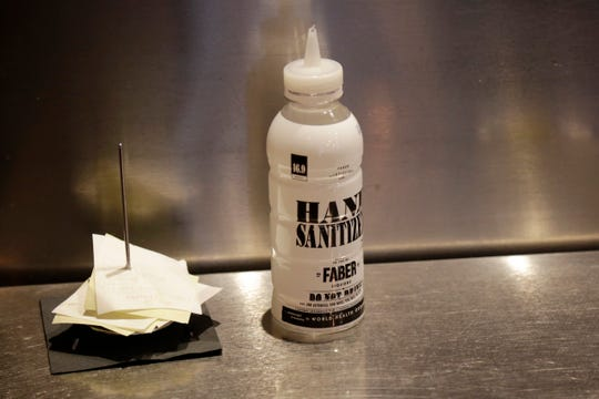Hand sanitizer is prepared at Zula in the Over-the-Rhine neighborhood of Cincinnati on Thursday, May 21, 2020.