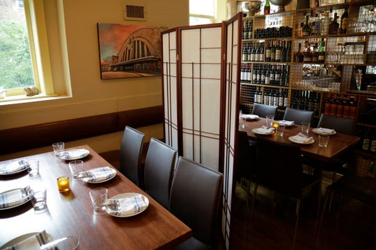 Dividers separate tables in the dining room at Zula in the Over-the-Rhine neighborhood of Cincinnati on Thursday, May 21, 2020.