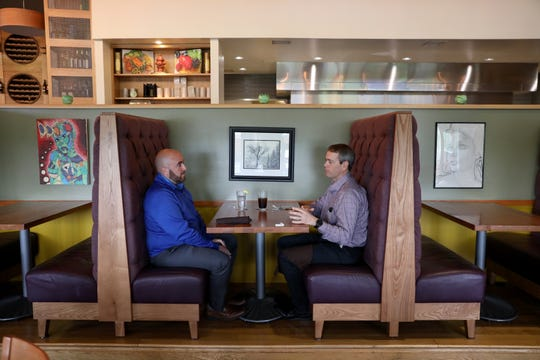 Mike Galati, of Anderson Township, left, enjoys lunch with John Daley, of Columbus, right, Thursday, May 21, 2020, at Brown Dog Cafe in Blue Ash, Ohio. Ohio Gov. Mike DeWine ordered restaurants and bars to stop indoor services by the night of March 15 to stop the spread of the novel coronavirus, and on Thursday, restaurants were able to open indoor dining rooms, contingent on following strict social distancing and sanitation measures.
