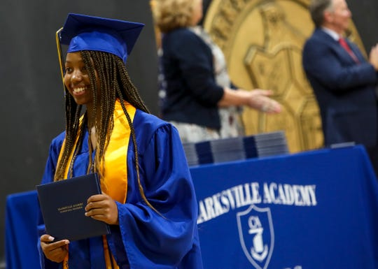Seniors from Clarksville Academy gather with faculty and family to walk across the stage and hold a graduation ceremony spaced six feet apart at Clarksville Academy gymnasium in Clarksville, Tenn., on Wednesday, May 20, 2020.