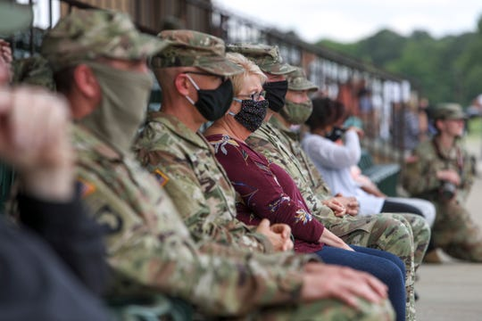 Soldiers and loved ones sit in bleachers waiting for the formations to be allowed to see family during a welcome home ceremony for soldiers from the 531st Hospital Center that had been deployed to New York to help at the Division Parade Field in Fort Campbell, KY., on Thursday, May 21, 2020.