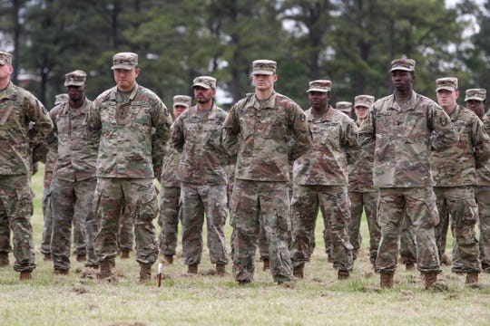 Soldiers stand in formation before being allowed to break and see their families during a welcome home ceremony for soldiers from the 531st Hospital Center that had been deployed to New York to help at the Division Parade Field in Fort Campbell, KY., on Thursday, May 21, 2020.