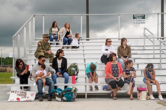Families and loved ones sit in bleachers awaiting their soldiers to be allowed to break formation during a welcome home ceremony for soldiers from the 531st Hospital Center that had been deployed to New York to help at the Division Parade Field in Fort Campbell, KY., on Thursday, May 21, 2020.