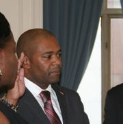 New Brunswick Councilman Glenn Fleming being sworn in to the city council.