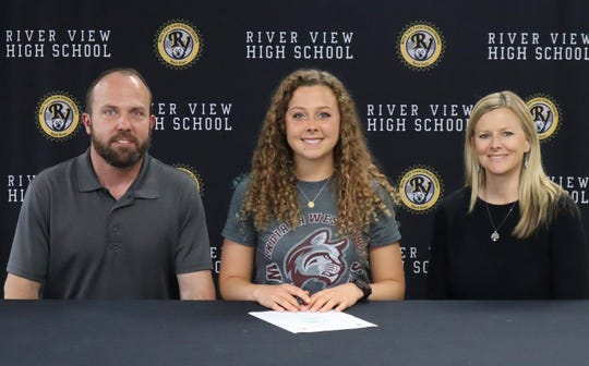 River View's Aliya Stevens (middle) signed to run track with Indiana Wesleyan on Wednesday.