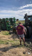 Iowa State offensive lineman Colin Newell got the tractor he was driving stuck in the mud.