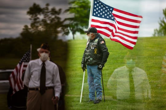 Veterans, Patriot Guard members, and members of the public attend a drive-by procession and ceremony to honor 'unclaimed' Vietnam veteran Russell A. Gipson, Jr. on May 21, 2020 at the Iowa Veterans Cemetery in Van Meter. Barbara Ann Miller, Russell's sister, discovered his death through an obituary. Russell was unknown to be living by his surviving sister, daughter, and nephew, who said they had become estranged from him over the years amid Gipson's schizophrenia, as well as a change back to his original birth name.