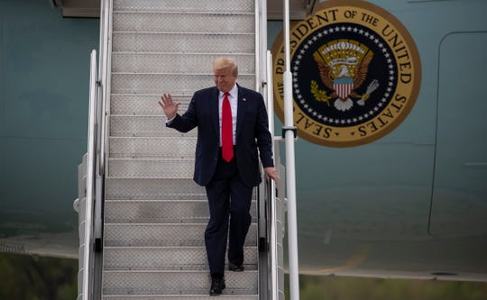 President Trump arrives at Detroit Metro Airport in Romulus for his visit to Ford's Rawsonville Plant, Thursday, May 21, 2020.