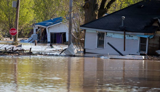 Remnants of buildings near downtown Sanford, Michigan are still surrounded by water May 20, 2020. Many homes and business in and around downtown were overcome by flood waters when the Sanford Dam failed.