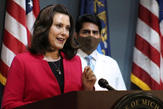 Gov. Gretchen Whitmer speaks at a press conference Thursday, May 21, 2020 in Lansing.