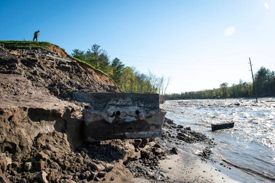 A man looks over at what is left of the Edenville Dam at Wixom Lake on May 21.