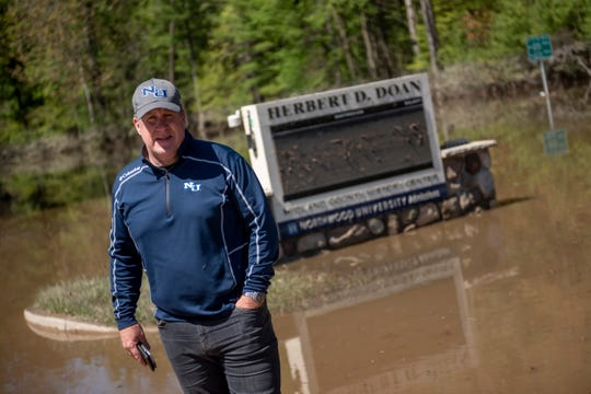 Kent MacDonald, president of Northwood University, poses for a photo on campus, in Midland, May 21, 2020.  The university was flooded after two area dams failed this week.