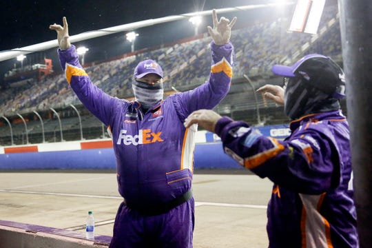 Members of Denny Hamlin's crew celebrate after Hamlin won the rain-shortened NASCAR Cup Series auto race Wednesday, May 20, 2020, in Darlington, S.C.