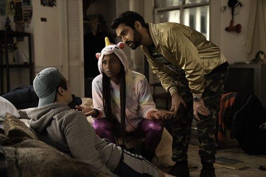 "Issa Rae and Kumail Nanjiani in ""The Lovebirds."""