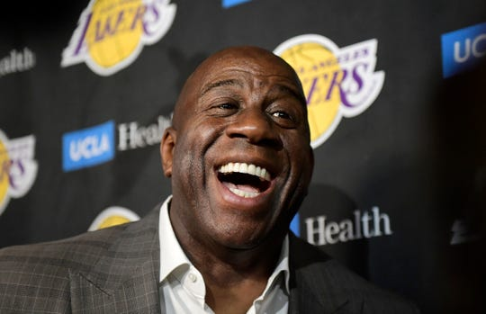 Magic Johnson's insurance company is funding $100 million in loans for minority- and women-owned businesses.