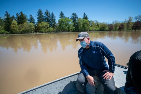 Kent MacDonald, president of Northwood University, looks at some of the flooding near campus, in Midland, May 21, 2020.