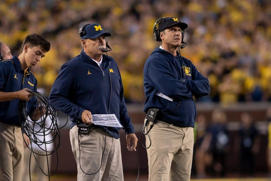Defensive coordinator Don Brown, left, is one of the many faces who is returning on Michigan coach Jim Harbaugh's staff.