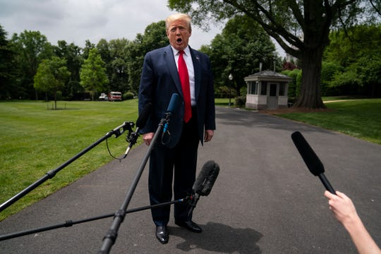 President Donald Trump talks to reporters before departing the White House for a trip to Michigan, Thursday, May 21, 2020, in Washington.