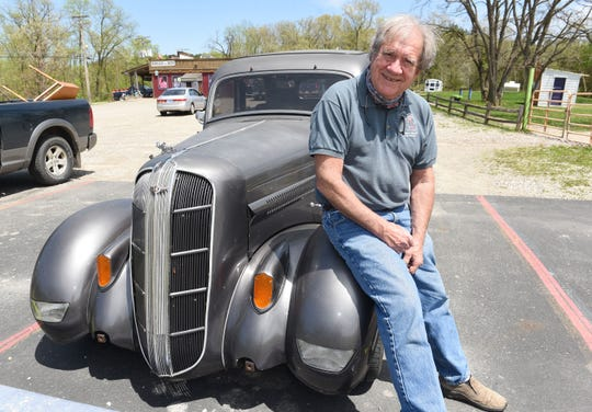 "John Colone with his 1936 Dodge two-door sedan with the license plate ""4HellMI."""