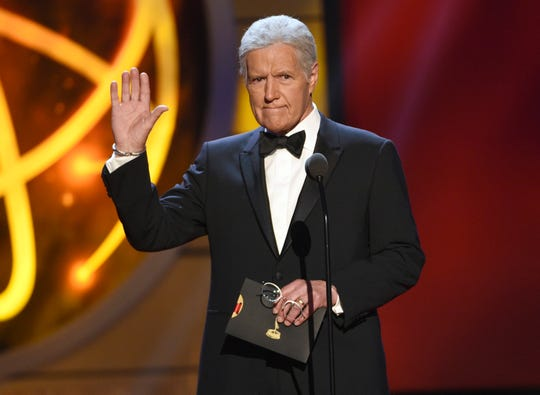 This May 5, 2019 file photo shows Alex Trebek presenting an award at the 46th annual Daytime Emmy Awards in Pasadena, Calif.