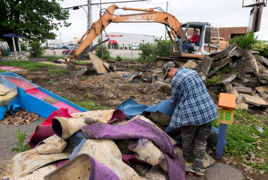 Lori Hancock stacks putting turf during the demolition of The Midget Links miniature golf course off East Morgan Avenue in Evansville, Ind., Wednesday afternoon, May 20, 2020. Roy and Esther Brenton opened Midget Links in 1947. They sold it to Paul Dayton in 1998 who continued operation until the 2020 season.