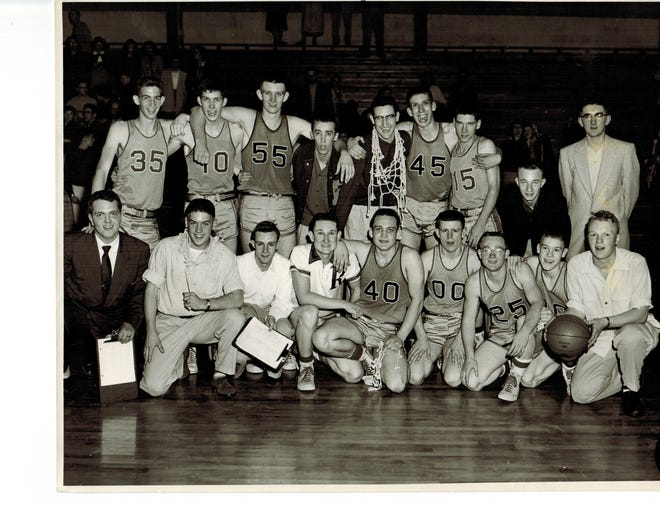 """The Rockport Zebras gathered for a photograph after winning the 1954 sectional. Bottom row: Ronnie Brand (manager), Bob Duvall (manager), Donnie Bates (statistician), Roger """"Pud"""" Vogel, Jerry Denstorff, Donnie Ice, Harold Matthews, Ronnie Englebrecht, Galen Snyder (manager). Top row: Bob Stoemer, Larry """"Buck"""" Erwin, John Jolly, Bill Golden, Coach Bob Sakel, Don Hinton, Delbert Lester, Leland Ayer, JT May"""