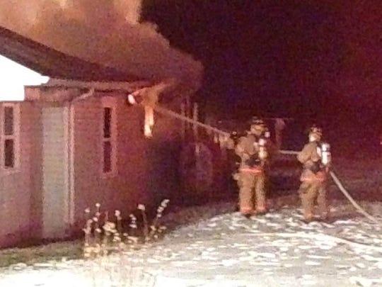 Ryan Gargas hoses a fire.