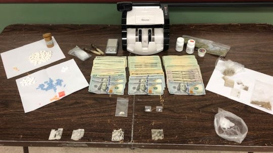The Lee County Sheriff's Office implemented an undercover drug operation, arrested three men at 587 Tennyson Drive in North Fort Myers on Wednesday, May 20, 2020. They confiscated the drugs and cash shown here.