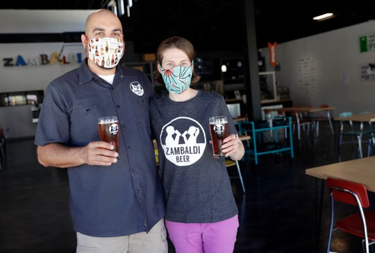 Zambaldi Beer owners David and Abby Malcolm inside their taproom shortly before the Allouez business reopened to cusomers on May 21, after having to temporarily close due to the coronavirus pandemic. Zambaldi will have new health safety procedures in place, including masks being worn by the staff, increased sanitization of surfaces, 6 feet between tables and a plastic divider at the order counter.